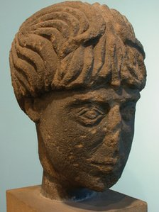 Carved stone head believed to be a Roman god