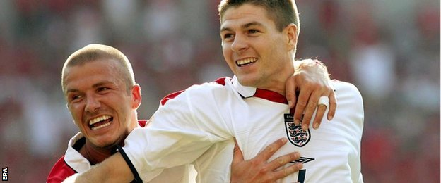 David Beckham and Steven Gerrard celebrate the Liverpool player's goal during England's Euro 2004 Group B victory over Switzerland in Coimbra, Portugal