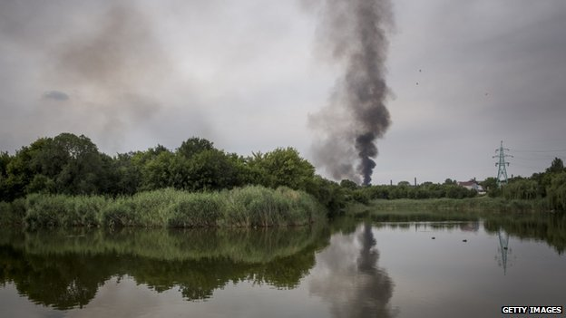 Smoke is seen billowing during fighting between pro-Russia rebels and Ukrainian government troops in Donetsk