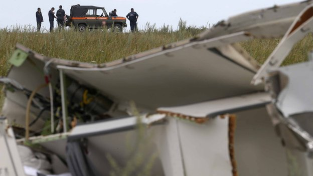 Members of the Ukrainian Emergencies Ministry gather before leaving the crash site of the Malaysia Airlines Flight MH17
