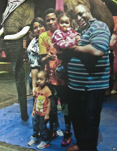 An undated photo of Eric Garner (right) with his family