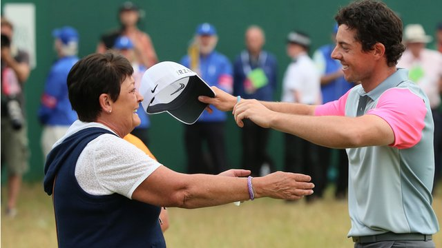 Rosie McIlroy embraces her son Rory after he clinched Open glory at Hoylake
