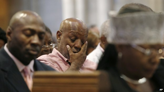 A man wiped his face at a service for Eric Garner in New York on 20 July 2014