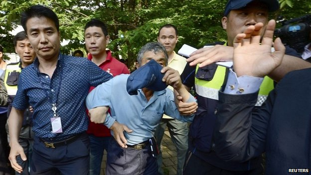 A man who is believed to have helped Yoo Byung-un to escape is detained by police at the businessman's church in Anseong - 11 June 2014
