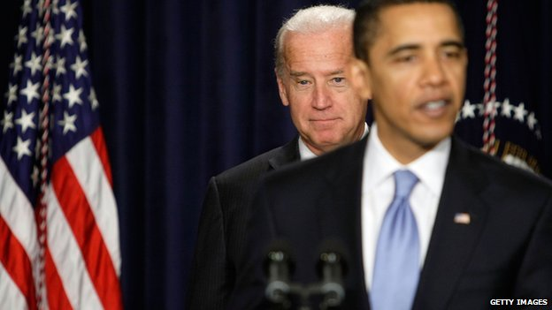 Vice-President Joe Biden stands behind President Barack Obama.