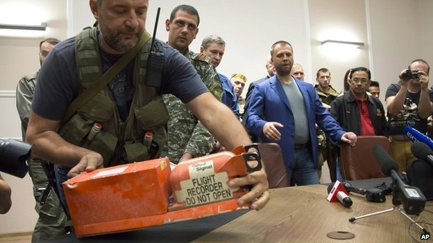 A rebel places a black box from flight MH17 on a table at a meeting to hand two data recorders over to Malaysian officials in Donetsk - 22 July 2014