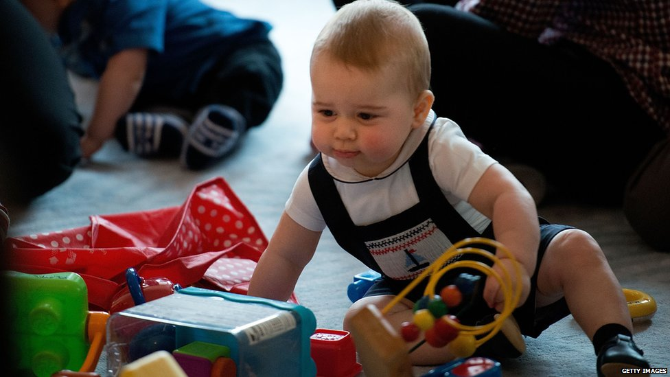 Prince George playing with toy in New Zealand.