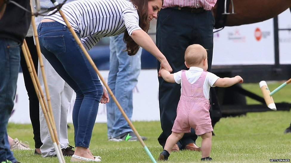 Prince George was photographed walking with the help of his mother