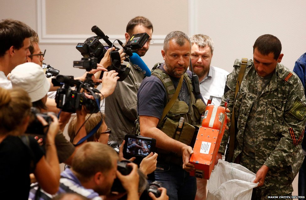A pro-Russian separatist shows the media a black box belonging to Malaysia Airlines flight MH17