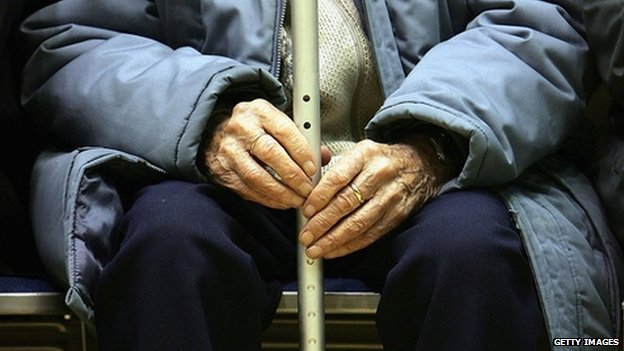 Pensioner with walking stick