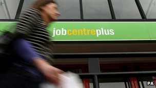 A person walking past a Job Centre
