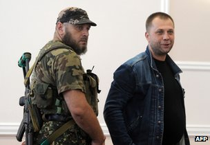Alexander Borodai with a bodyguard in Donetsk, 20 July