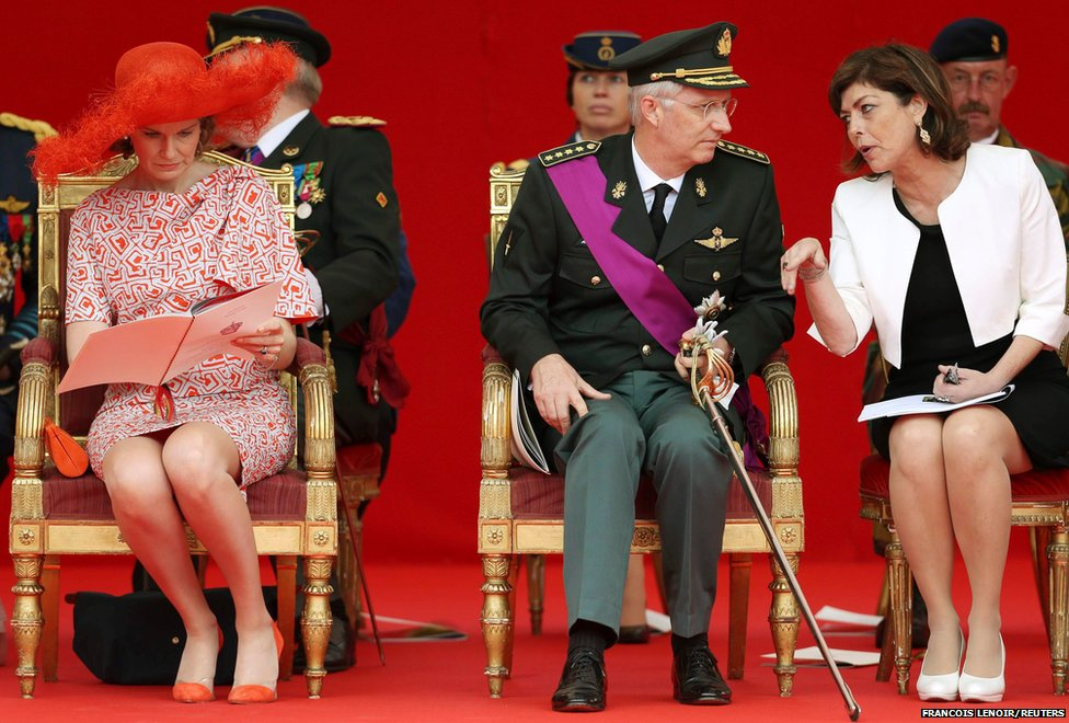 Belgium's Queen Mathilde, King Philippe and Interior Minister Joelle Milquet watch a traditional military parade