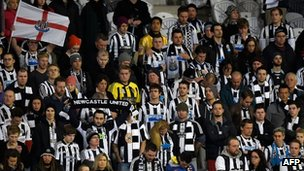 Newcastle United fans join the team in a moment of silence in honour of two fans of the team who lost their lives in the MH17 crash during a game between Sydney FC and Newcastle at the Forsyth Barr Stadium in Dunedin, New Zealand