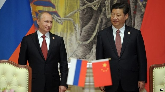 Russia President Vladimir Putin and China President Xi Jinping at a signing ceremony for landmark gas deal
