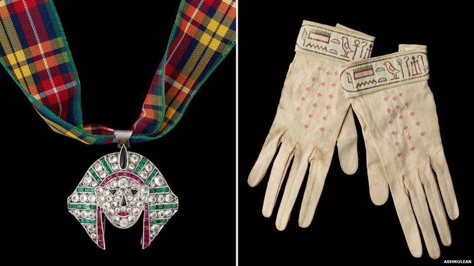 Pharoah head pendant and leather gloves, 1920s