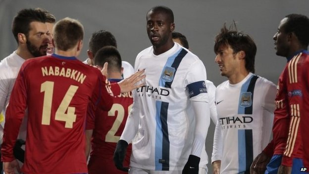 Manchester City's Yaya Toure, centre, talks to CSKA's Kirill Nababkin  during a Champions League Group D match in Moscow in October, 2013