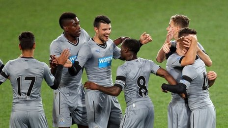 Newcastle players celebrating a goal