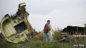A Malaysian air crash investigator inspects the crash site of Malaysia Airlines Flight MH17 (22 July 2014)