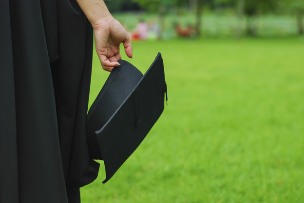 Woman carrying mortarboard