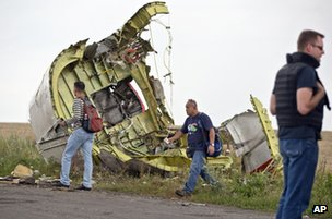 Malaysian air crash investigators near the village of Grabove, east Ukraine, 22 July