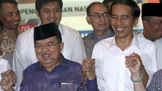 Joko Widodo, right, and running-mate Jusuf Kalla celebrates election win. 22 July 2014