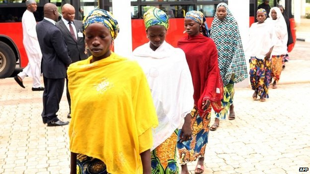 Some of the Chibok schoolgirls who escaped Islamist captors alight from a bus to attend a meeting with Nigerian President Goodluck Jonathan at the presidency in Abuja on 22 July 2014