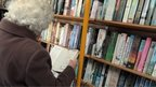 Woman browses books in a mobile library