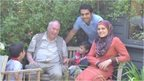 Hassan Hallaq and his family with Sir Iain Chalmers