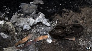A shoe lies next to melted aluminum at the crash site of Malaysia Airlines Flight 17