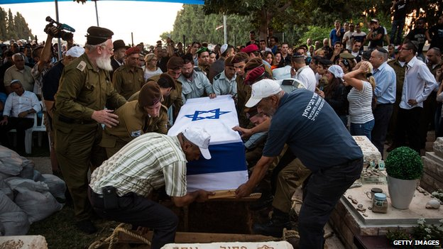 The casket carrying the body of Israeli soldier Jordan Bensimon is carried to the burial site during his funeral on July 22, 2014 in Ashkelon, Israel