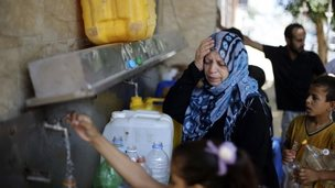 Gaza people get water from a public tap - 19 July