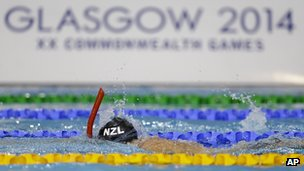A swimmer practices using a snorkel during a training session at the Tollcross International Swimming Centre