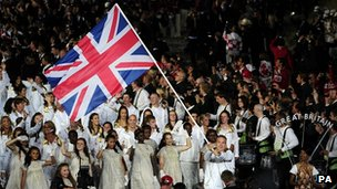Sir Chris Hoy carries the flag during the opening ceremony