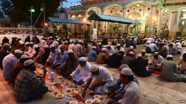 Indian Muslims break their fast during the holy month of Ramadan in Hyderabad on July 18, 2014.</body></html>