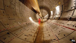 A Crossrail worker inspects the first completed section of Crossrail tunnel,
