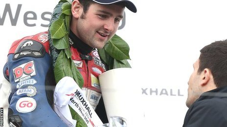 Michael Dunlop collects his trophy after the Superstock victory