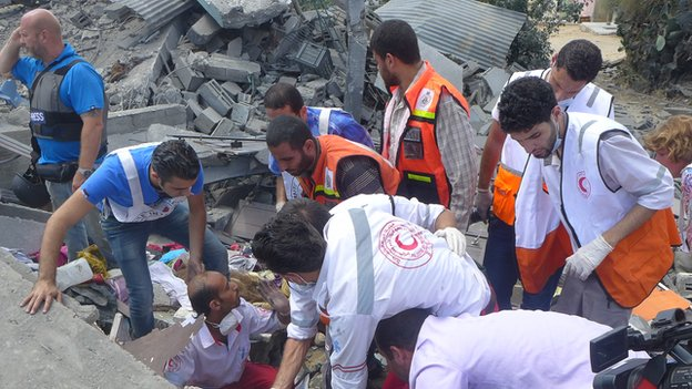 Rescuers find critically injured Asmaa el-Helou buried deep in the rubble of her home earlier this week
