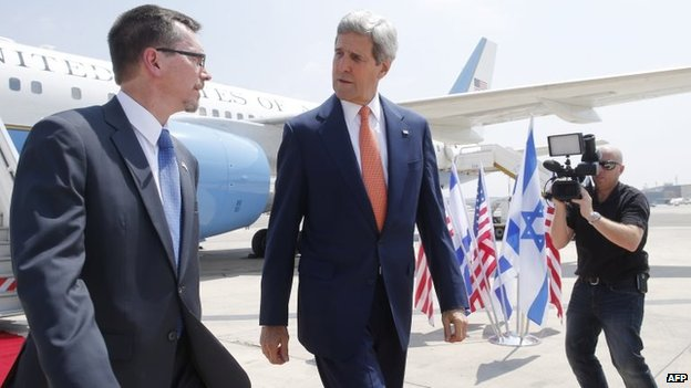 US Secretary of State John Kerry (centre) walks with US embassy Deputy Chief of Mission Bill Grant at Ben Gurion airport as he arrives in Israel, 23 July 2014