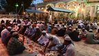 Indian Muslims break their fast during the holy month of Ramadana in Hyderabad on July 18, 2014.