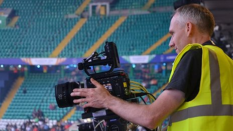 A BBC R&D engineer sets up one of the UHD cameras at a games venue