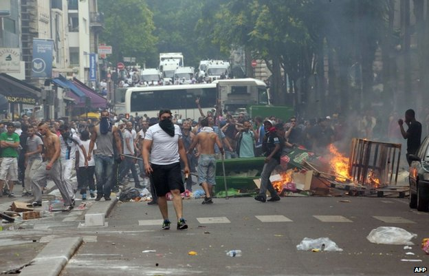 Rioters face police in Barbes, Paris, 20 July