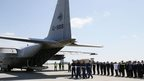 Honour guards carry a coffin of one of the victims of Malaysia Airlines MH17 at Kharkiv airport July 23