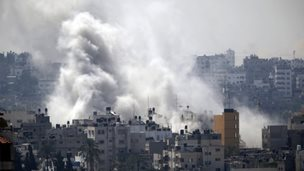 Smoke from an Israeli strike rises over Gaza City, 23 July 2014