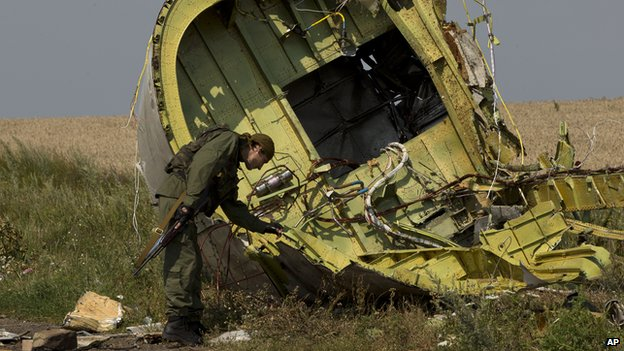 A pro-Russian rebel at the MH17 wreckage