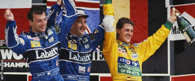 Nigel Mansell of Great Britain celebrates winning with 2nd placed team mate Riccardo Patrese and third placed Michael Schumacher during the Mexican Grand Prix on 22nd March 1992 at the Autodromo Hermanos Rodríguez in Mexico City, Mexico.