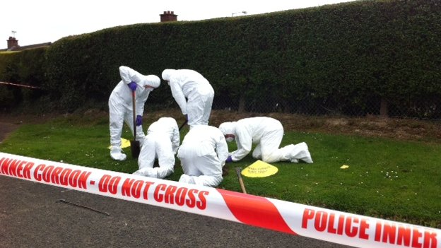 Forensic scientists at scene of shooting