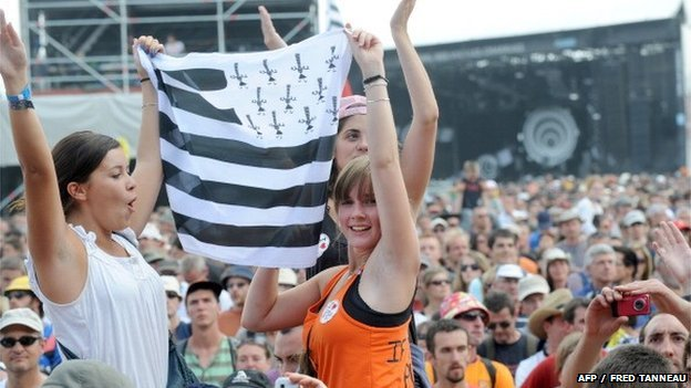 Fans holding a Breton flag at the opening of the Vieilles Charrues festival in Carhaix