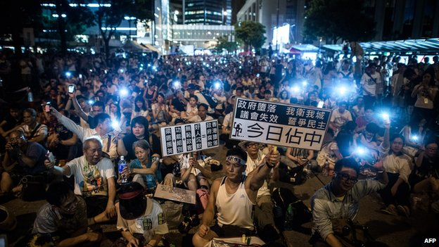 Demonstrators sit in a street of the central district after a pro-democracy rally seeking greater democracy in Hong Kong on 1 July 2014.