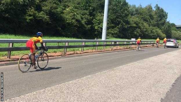 The Sri Lankan team cyclists photographed on the M74 by Team England triathlete Alistair Brownlee